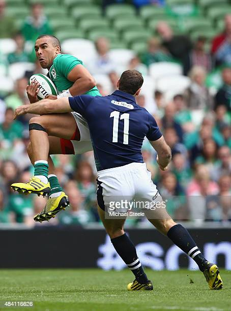 Simon Zebo of Ireland claims a high ball as Tim Visser of Scotland closes in during the International match between Ireland and Scotland at the Aviva...