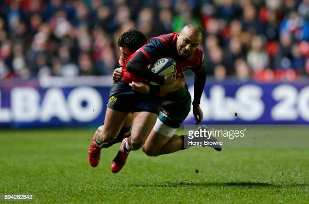 Simon Zebo of Munster and Matt Toomua of Leicester Tigers during the European Rugby Champions Cup match between Leicester Tigers and Munster Rugby at...