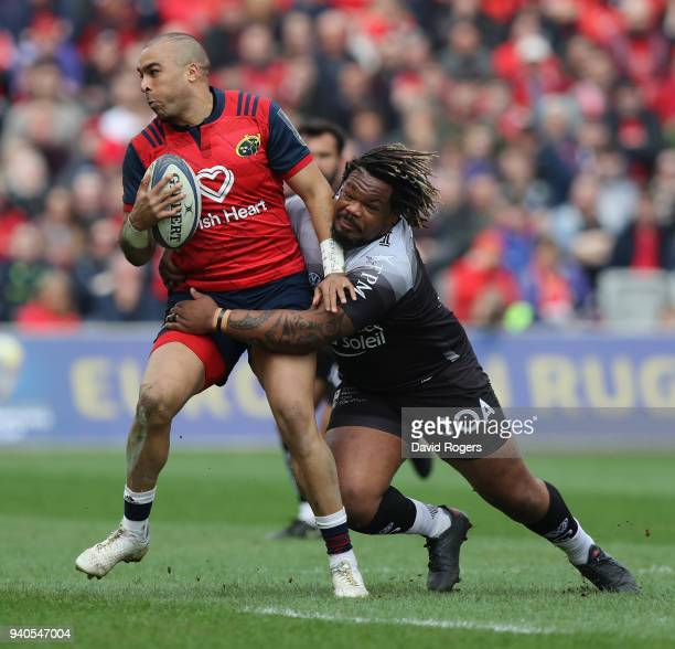 Simon Zebo of Munster is tackled by Mathieu Bastareaud during the European Rugby Champions Cup match between Munster Rugby and RC Toulon at Thomond...