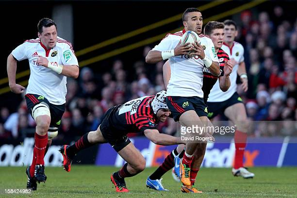 Simon Zebo of Munster makes a break during the Heineken Cup pool one match between Saracens and Munster at Vicarage Road on December 16 2012 in...