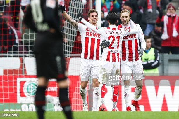 Simon Zoller of 1FC Koeln celebrates with Leonardo Bittencourt of 1FC Koeln and Marcel Risse of 1FC Koeln after scoring his teams second goal during...