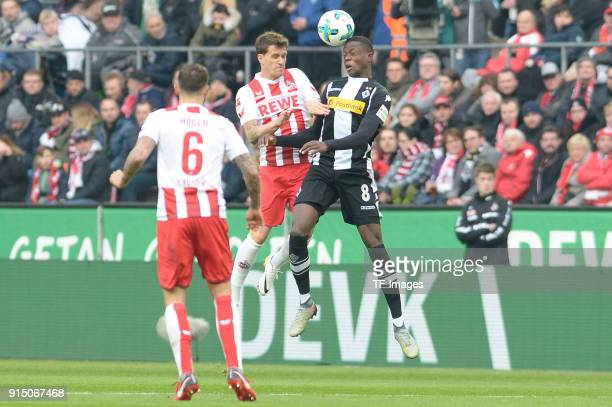 Simon Zoller of Koeln and Denis Zakaria of Moenchengladbach battle for the ball during the Bundesliga match between 1 FC Koeln and Borussia...