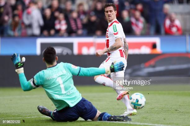 Simon Zoller of Koeln attempts to score against goalkeeper Philipp Tschauner of Hannover during the Bundesliga match between 1 FC Koeln and Hannover...