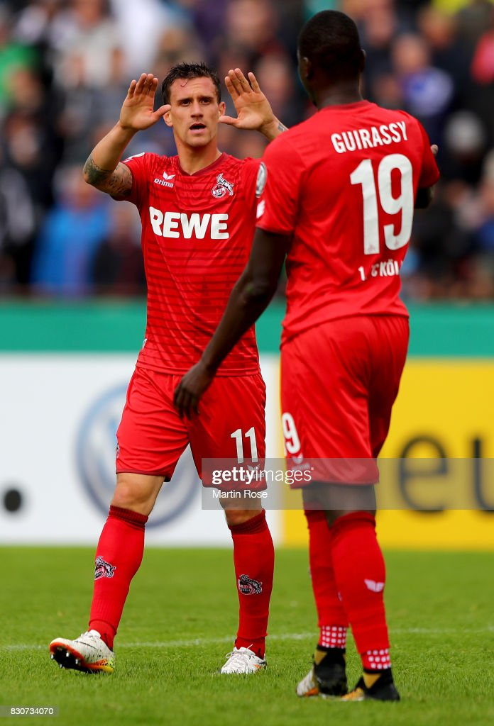 Simon Zoller (L) of Koeln celebrates after he scores the 5th goal during the DFB Cup first round match between Leher TS and 1. FC Koeln at Nordseestadion on August 12, 2017 in Bremerhaven, Germany.