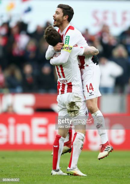 Simon Zoller of Koeln celebrates his team's second goal with team mate Jonas Hector during the Bundesliga match between 1 FC Koeln and Bayer 04...