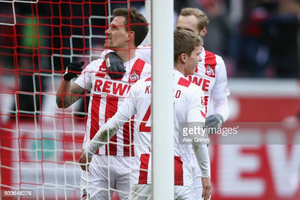 Simon Zoller of Koeln celebrates his team's second goal with team mates Vincent Koziello and Marcel Risse during the Bundesliga match between 1 FC...