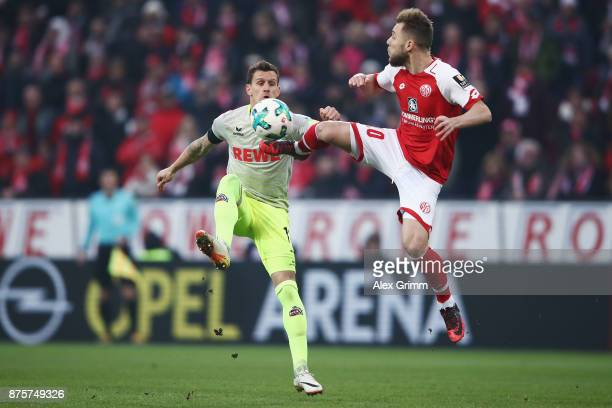 Simon Zoller of Koeln is challenged by Alexandru Maxim of Mainz during the Bundesliga match between 1 FSV Mainz 05 and 1 FC Koeln at Opel Arena on...
