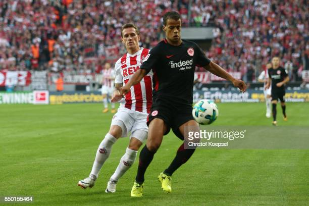 Simon Zoller of Koeln with Timothy Chandler of Frankfurt during the Bundesliga match between 1 FC Koeln and Eintracht Frankfurt at...