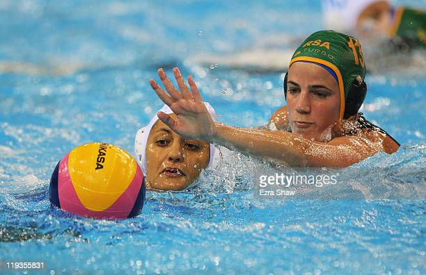 Simona Abbate of Italy fights for control of the ball against Jemma Dendy Young of South Africa as they compete in the Women's Water Polo first...