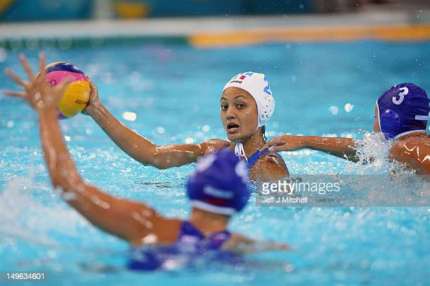 Simona Abbate of Italy is tackled by Ekaterina Prokoyrva of Russia on Day 5 of the London 2012 Olympics at Water Polo Arena on August 1 2012 in...