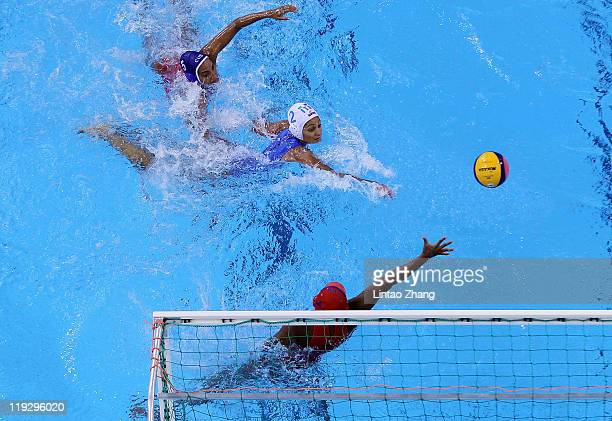Simona Abbate of Italy scores in the Women's Water Polo first preliminary round match between Italy and Cuba during Day Two of the 14th FINA World...