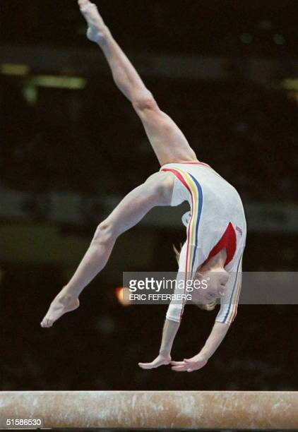 Simona Amanar of Romania performs on the balance beam during the compulsories of the Olympic gymnastics event at the Georgia Dome in Atlanta Georgia...