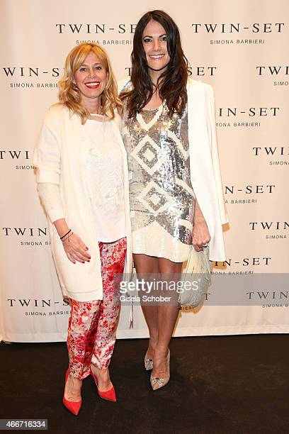 Simona Barbieri and Bettina Zimmermann pose during the TWINSET Simona Barbieri FlagshipStore Opening Event on March 18 2015 in Munich Germany
