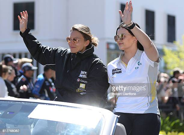 Simona De Silvestro and Renee Gracie of the Harvey Norman Supergirls Team wave to the crowd during the drivers parade ahead of the Bathurst 1000...