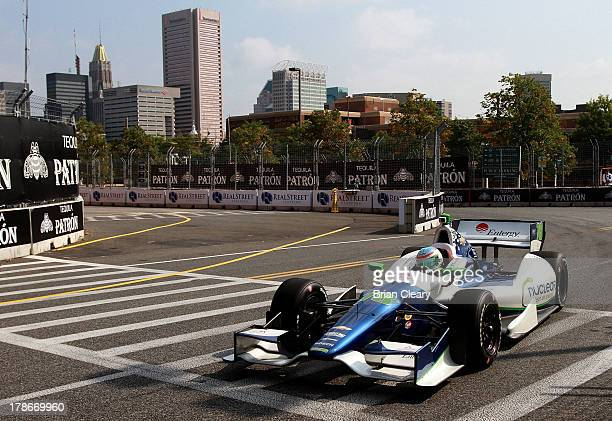 Simona De Silvestro of Switzerland driver of the KV Racing Technology Chevrolet Dallara races past buildings during practice for the Grand Prix of...