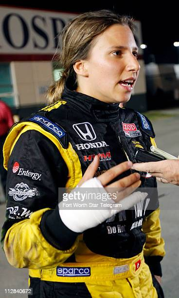 Simona De Silvestro talks to the media after receiving treatment for minor burns to her right hand after her car caught fire in a crash during the...