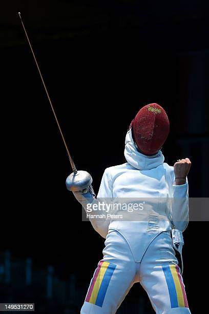 Simona Gherman of Romania celebrates after a point against Laura Flessel-Colovic of France during the Women's Epee Individual Fencing round of 16 on...