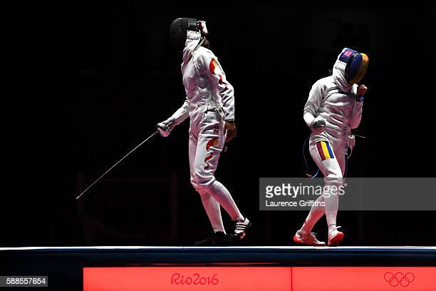 Simona Gherman of Romania celebrates against Anqi Xu of China during the Women's Epee Team Gold Medal Match bout on Day 6 of the 2016 Rio Olympics at...