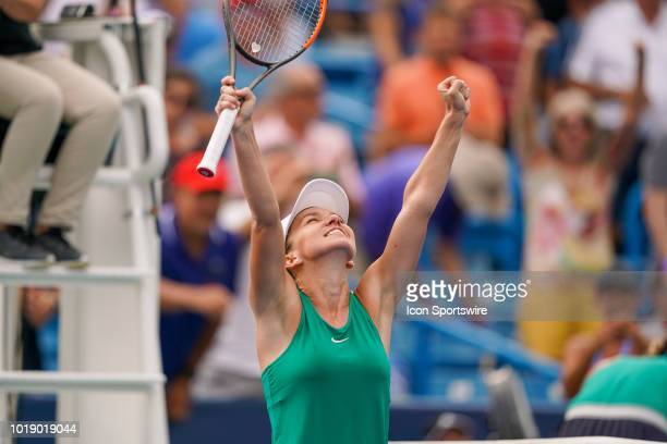 Simona Halep celebrates after defeating Aryna Sabalenka during the semifinal match at the Western Southern Open at the Lindner Family Tennis Center...