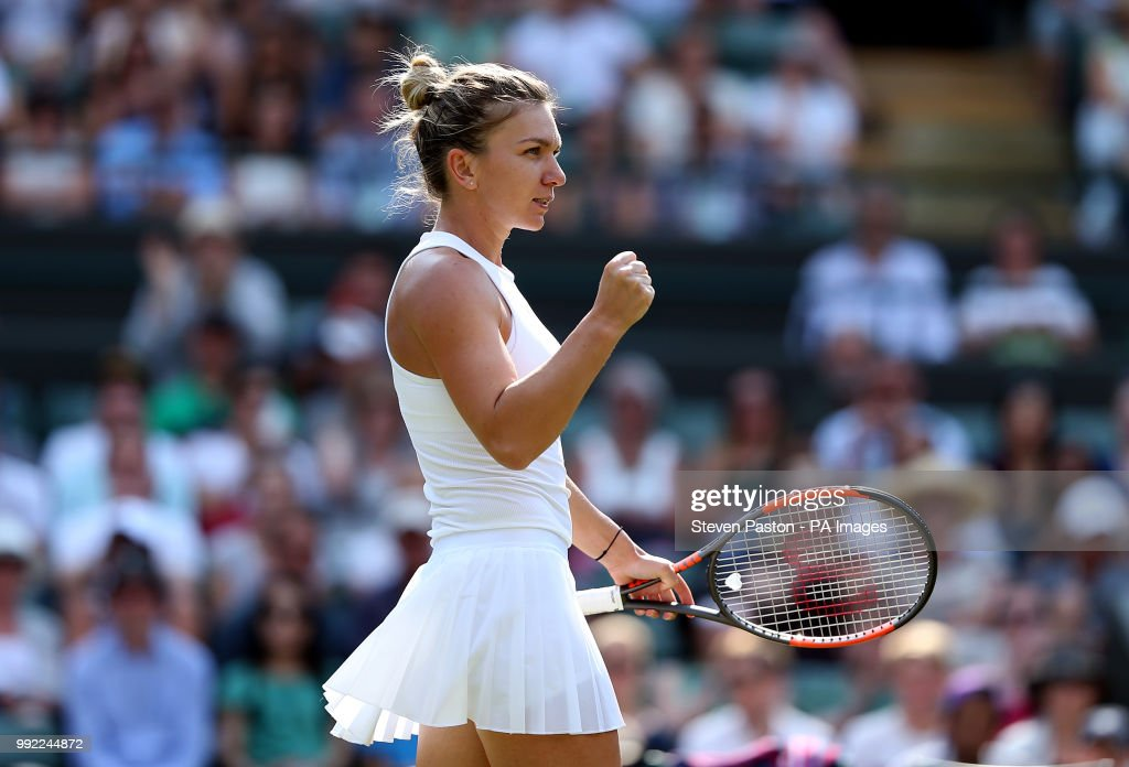 Simona Halep celebrates her win against Saisai Zheng on day four of the Wimbledon Championships at the All England Lawn Tennis and Croquet Club, Wimbledon.