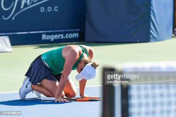 Simona Halep falls on the ground after winning a 2h41 long match at the WTA Coupe Rogers final on August 12, 2018 at IGA Stadium in Montréal, QC