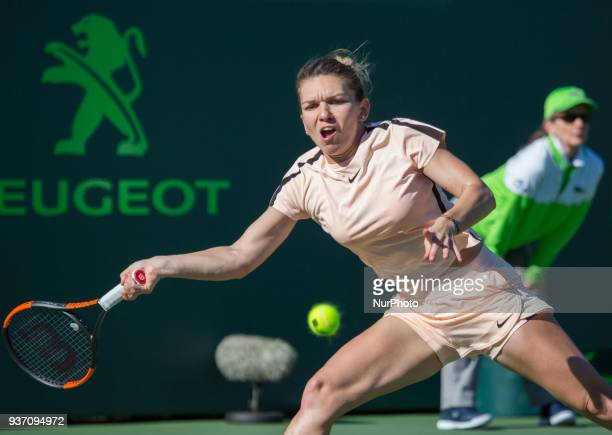 Simona Halep from Romania in action at the Miami Open's Center Court during her match against Ocean Dodin from France in their second round match...