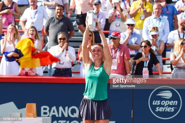 Simona Halep holds her trophy after winning the WTA Coupe Rogers 2018 final on August 12, 2018 at IGA Stadium in Montréal, QC