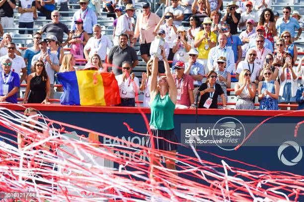 Simona Halep holds her trophy high in the air after ribbons were launched in the air after her win of the WTA Coupe Rogers 2018 final on August 12,...
