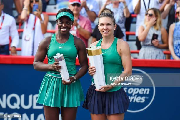 Simona Halep holds her winner trophy beside Sloane Stephens the WTA Coupe Rogers 2018 final match on August 12 2018 at IGA Stadium in Montréal QC