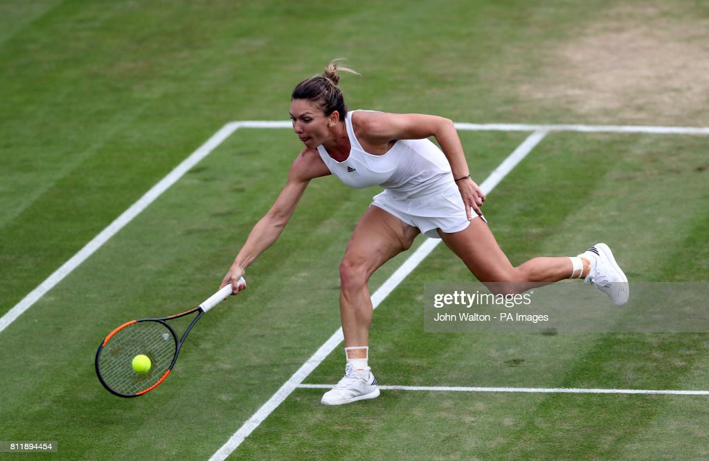 Simona Halep in action against Victoria Azarenka on day seven of the Wimbledon Championships at The All England Lawn Tennis and Croquet Club, Wimbledon.