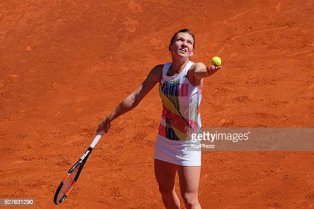 Simona Halep in action their match during day fourth of the Mutua Madrid Open tennis tournament at the Caja Magica on May 03 2016 in MadridSpain