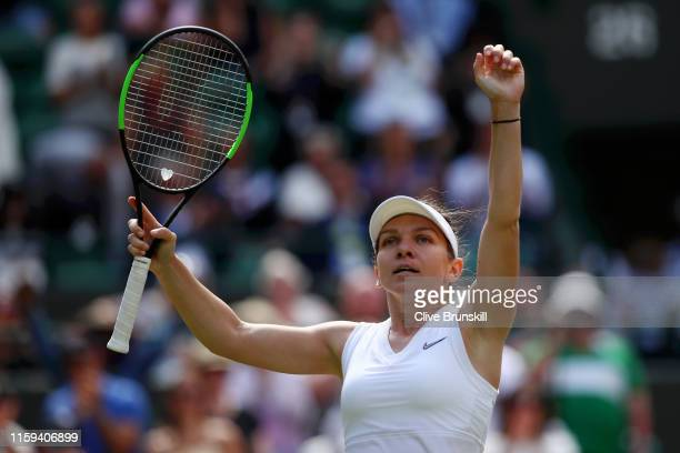 Simona Halep of Romania acknowledges the crowd as she celebrates victory after her Ladies' Singles first round match against Aliaksandra Sasnovich of...