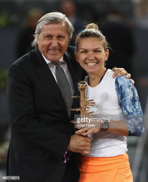Simona Halep of Romania and Ille Nastase with the winners trophy after she defeated Kristina Mladenovic of France in the final during day eight of...