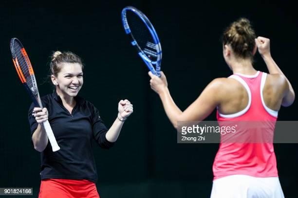 Simona Halep of Romania and IrinaCamelia Begu of Romania celebrate winning the doubles final match against Barbora Krejcikova of Czech Republic and...