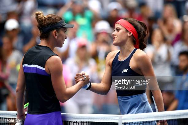 Simona Halep of Romania and Nicole Gibbs of the United States shake hands following their Women's Singles first round match on day two of the 2019 US...