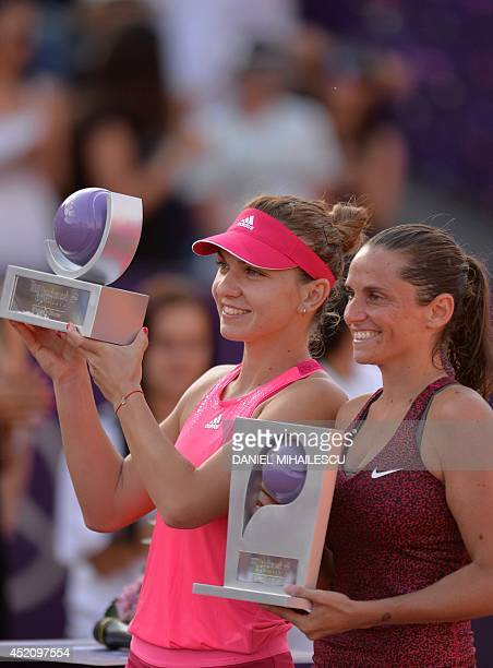 Simona Halep of Romania and Roberta Vinci of Italy hold their trophy after the single final at the WTA Bucharest tennis tournament in Bucharest on...