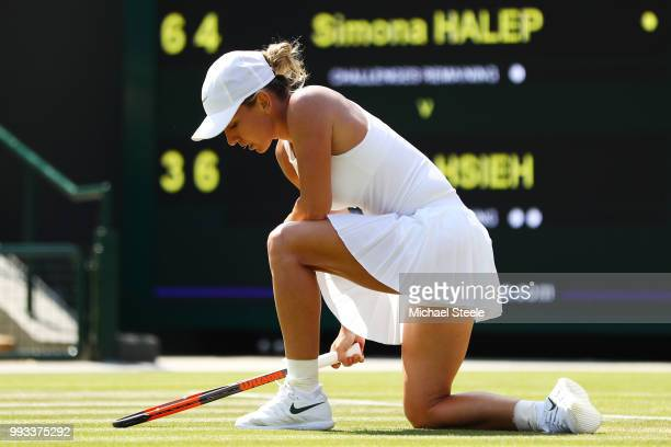 Simona Halep of Romania appears dejected during her Ladies' Singles second round match against SuWei Hsieh of Taiwan on day six of the Wimbledon Lawn...