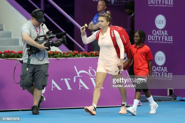 Simona Halep of Romania arrives for her match against Anastasija Sevastova of Latvia in the round of 16 during the Qatar Open tennis competition in...