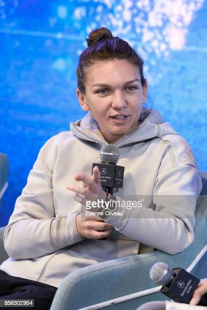 Simona Halep of Romania attends an event in the Mercedes-Benz booth during day two of the 2017 China Open at the China National Tennis Centre on...