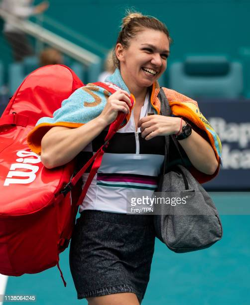 Simona Halep of Romania celebrates after beating Polona Hercog of Slovenia in the third round of the women's singles in the Miami Open at the Hard...