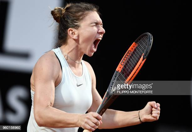 TOPSHOT Simona Halep of Romania celebrates after beating Russia's Maria Sharapova during the semifinal match at the WTA Tennis Open tournament at the...