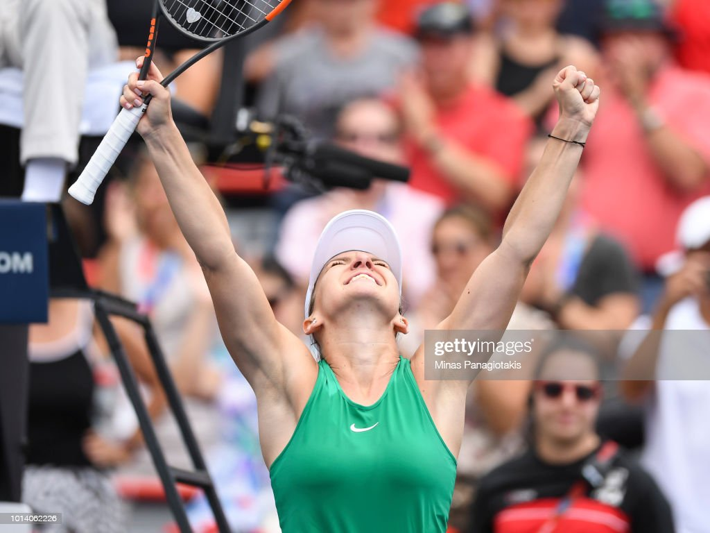 Simona Halep of Romania celebrates after defeating Anastasia Pavlyuchenkova of Russia 7-6, 4-6, 7-5 during day four of the Rogers Cup at IGA Stadium on August 9, 2018 in Montreal, Quebec, Canada.
