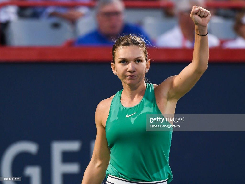 Simona Halep of Romania celebrates after defeating Caroline Garcia of France 7-5, 6-1 during day five of the Rogers Cup at IGA Stadium on August 10, 2018 in Montreal, Quebec, Canada.