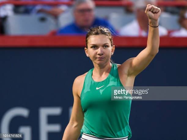 Simona Halep of Romania celebrates after defeating Caroline Garcia of France 75 61 during day five of the Rogers Cup at IGA Stadium on August 10 2018...