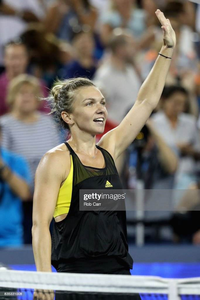 Simona Halep of Romania celebrates after defeating Johanna Konta of Great Britain during Day 7 of the Western and Southern Open at the Linder Family Tennis Center on August 18, 2017 in Mason, Ohio.