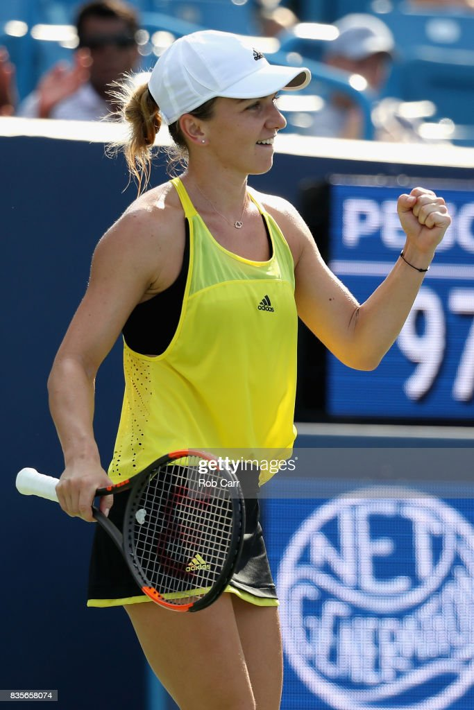 Simona Halep of Romania celebrates after defeating Sloane Stephens during Day 8 of the Western and Southern Open at the Linder Family Tennis Center on August 19, 2017 in Mason, Ohio.