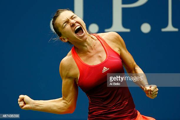 Simona Halep of Romania celebrates after defeating Victoria Azarenka of Belarus during their Women's Singles Quarterfinals match on Day Ten of the...