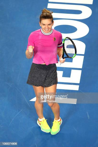 Simona Halep of Romania celebrates after match point in her first round match against Kaia Kanepi of Estonia during day two of the 2019 Australian...