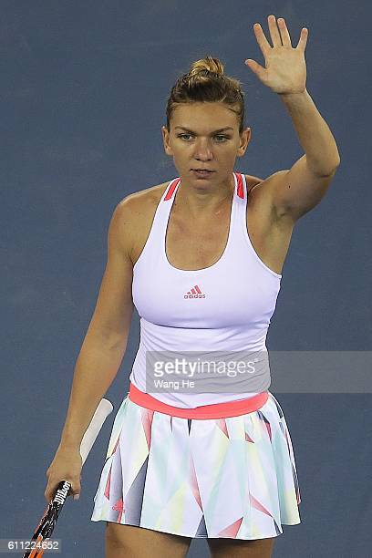 Simona Halep of Romania celebrates after she won the match against Madison Keys of USA on Day 5 of the 2016 Dongfeng Motor Wuhan Open at the Optics...