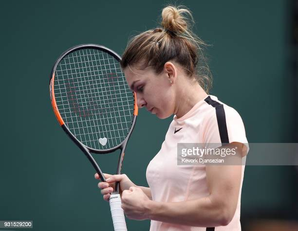 Simona Halep of Romania celebrates after winning a game against Qiang Wang of China during Day 9 of BNP Paribas Open on March 13 2018 in Indian Wells...